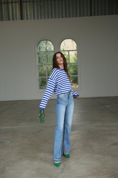 Yanı Yırtmaçlı Paça Kesik Detay Jean